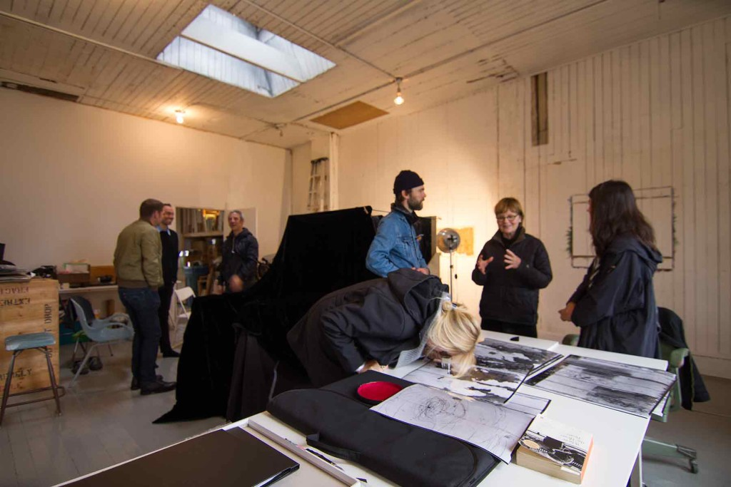 photo showing large format 16x20 camera and group at studio event