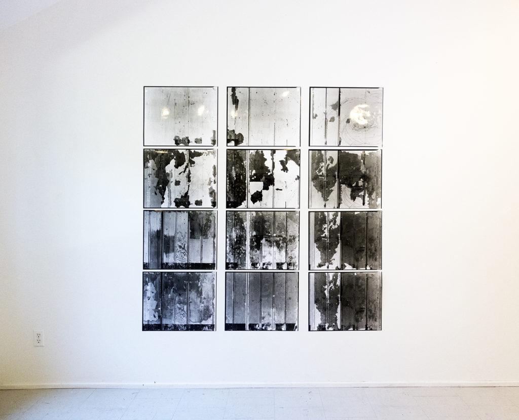 photograph showing artwork 562 Fisgard (wall peel): 12 - 16x20 photographs. 2016. Lynda Gammon and Trudi Lynn Smith. Documentation by Lynda Gammon.